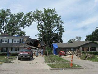 Smashed garage and car