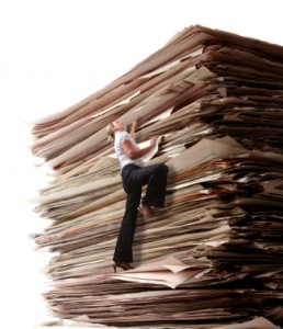 Stack of papers overbooked and underpaid
