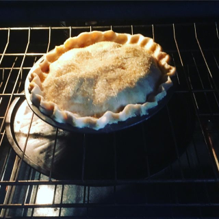 pie with pizza pan underneath to catch juice